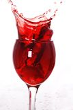 Red wine splashing out Stock Photo