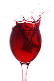 Red wine splashing out Stock Images