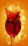 Red wine splashing out Royalty Free Stock Photography