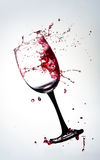 Red Wine Splatter. A Glass of Red Wine Flying through the air royalty free stock photo
