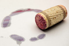 Red wine stain and cork. Cork of red wine with stain on the ground Royalty Free Stock Photos