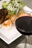 Red Wine with Steak and Seafoo Stock Image