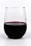 Red Wine in a stemless wine glass. Wine Glass with red wine stock photo