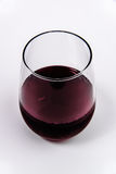 Red Wine in a stemless wine glass from top. Wine Glass with red wine royalty free stock image