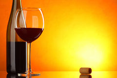 Red wine. Still-life with glass and bottle with big space for text Royalty Free Stock Images