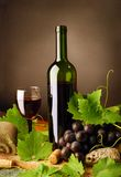 Red wine still life with sandstones Royalty Free Stock Images