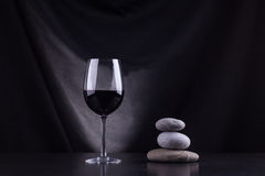 Red wine and stones Royalty Free Stock Photography