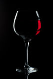 Red wine in structured glass. Red wine in a structured  glass with black background Stock Images