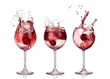 Red wine swirling in a goblet wine glass, isolated on a white ba. Ckground royalty free stock photo