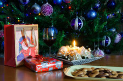 Red wine on table with Christmas tree Stock Photography