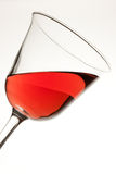 Red Wine in Tilted Glass Stock Images