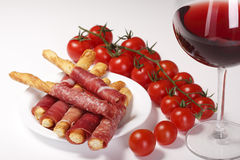 Red wine, tomato and cheese sticks with meat Royalty Free Stock Image