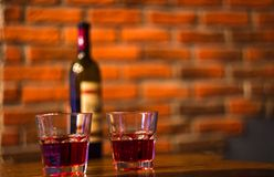 Red wine two glasses and a bottle. Two glasses of red wine bar phone hookah Stock Images