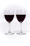 Red Wine in two glasses side by side Stock Images