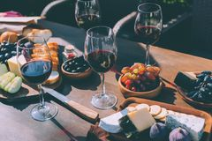 Red wine with various snacks royalty free stock images