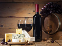 Red wine with various types of cheese on wooden background Stock Photo