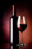Red wine on vinous background Stock Image