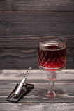 Red wine and vintage corkscrew Royalty Free Stock Image