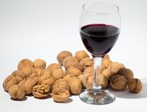 Red wine and walnut on background royalty free stock images