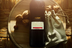 Red wine, walnuts and figs on wooden background stock photo