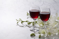 Red wine and white flowers Stock Image