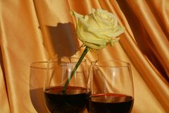 Red wine and white rose royalty free stock images