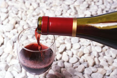 Red wine on the white stone.  Stock Photos