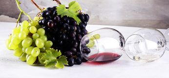 Red Wine and white wine with grapes and glasses on rustic backgr. Ound Stock Photo