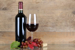Red wine in wine bottle and glass Royalty Free Stock Image