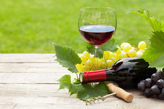 Red wine, wine bottle and grape. On wooden table with copy space Stock Photo