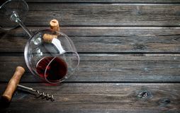 Red wine in a wine glass with a corkscrew stock photo