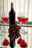 Red wine wine and grapes. Stock Images
