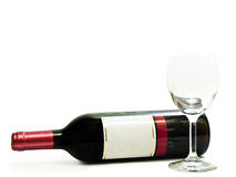 Red wine with wineglass. Bottle of the red wine with wineglass against the white background Royalty Free Stock Photography