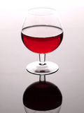 Red wine and wineglass. Beautiful glass stock images
