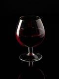 Red wine and wineglass. Beautiful glass royalty free stock photo