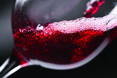 Red wine in wineglass. On dark background royalty free stock photography