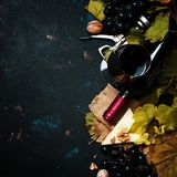 Red wine in wineglass from grape varieties cabernet sauvignon, d. Rink background, top view stock photography