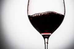 Red wine in wineglass. Red wine in wineglass on grey background. Closeup royalty free stock photo