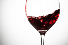 Red wine in wineglass. Red wine in wineglass on grey background. Closeup royalty free stock photography
