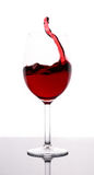 Red wine and wineglass. Isolated royalty free stock photos