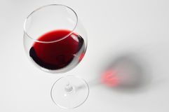 Red wine. Wineglass with red wine on white background Stock Photography