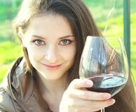Red wine. Woman drinking red wine Stock Photography