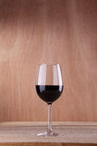Red wine on wood Stock Images