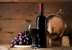 Red wine on wooden background Royalty Free Stock Image
