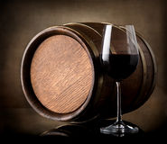 Red wine and a wooden barrel Stock Image