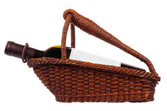 Red wine in wooden basket Royalty Free Stock Images