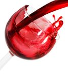 Red Wine2. Red wine being poured into a glass with white background Royalty Free Stock Photo