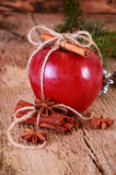 Red winter apple with cinnamon sticks and anise Stock Photos