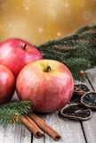 Red winter apples with cinnamon sticks Stock Photo