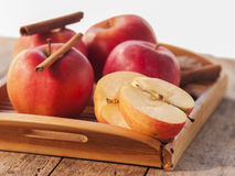 Red winter apples with cinnamon sticks Stock Photos